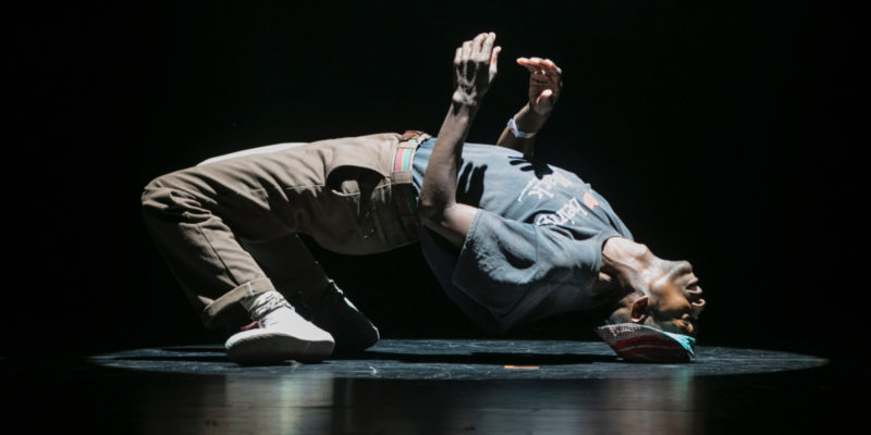 One of the Soweto Skeleton Movers bends over backwards so his head touches the floor as part of a performance at Breakin' Convention.